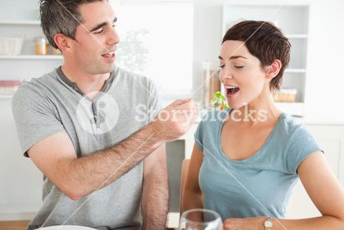 Man feeding his wife