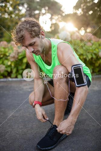 Man tying his shoe laces