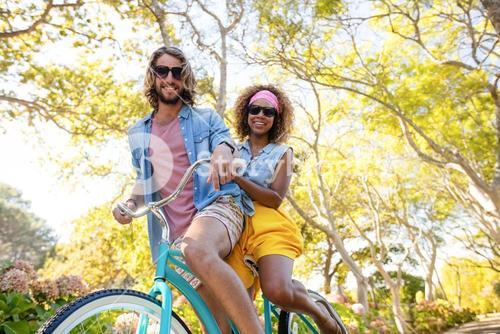 Couple cycling in the park