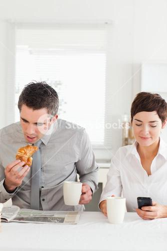 Cute couple having breakfast together