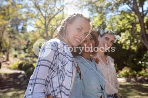 Female friends standing together with arm around