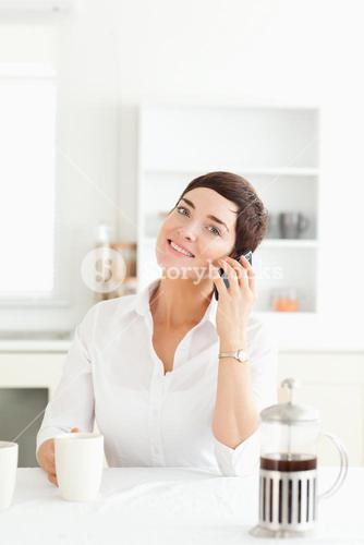 Cute woman on phone in the morning