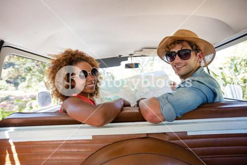 Couple sitting in campervan