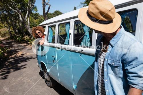 Man interacting with woman in campervan
