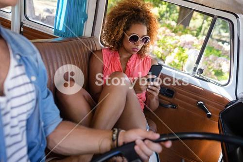 Woman using mobile phone while travelling