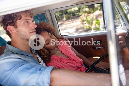 Couple travelling in campervan