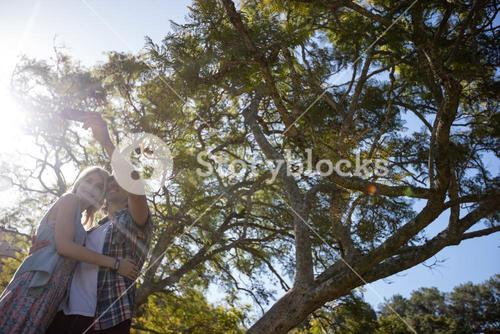 Couple clicking a selfie in park