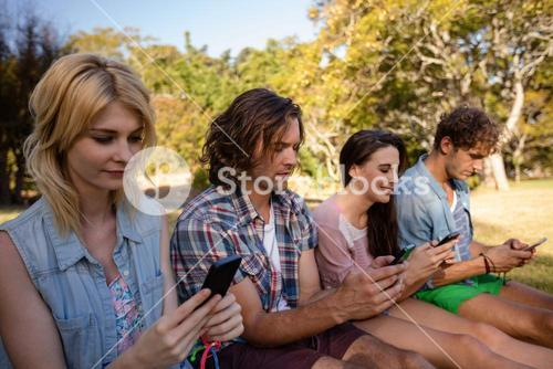 Friends text messaging on mobile phone