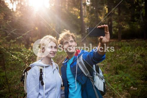 Hiking couple taking a selfie
