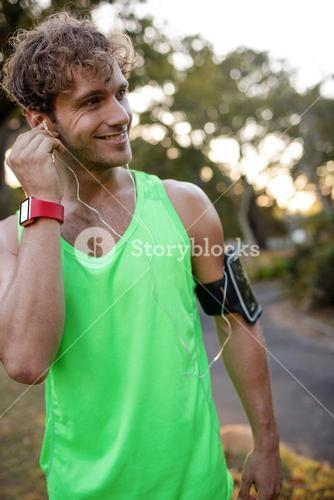 Jogger listening to music on mobile phone