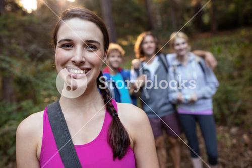 Portrait of smiling woman hiking with her friends