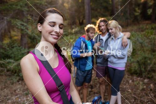 Smiling woman hiking with her friends