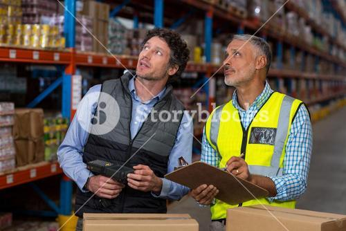 Warehouse workers checking the inventory