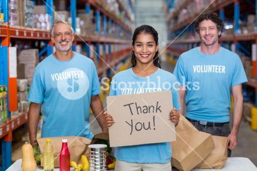 Happy colleagues holding sign boards with thank you message