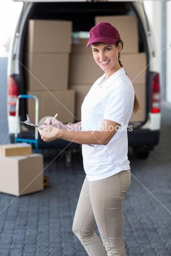 Portrait of delivery woman holding a clipboard