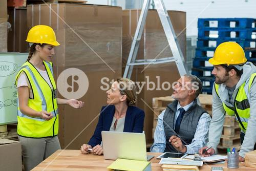 Warehouse worker interacting with manager