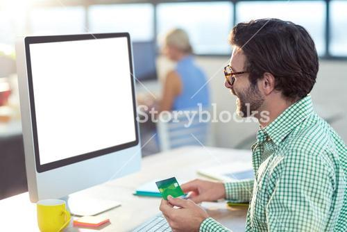 Graphic designer doing online shopping