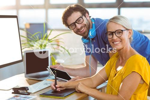 Graphic designers smiling in office