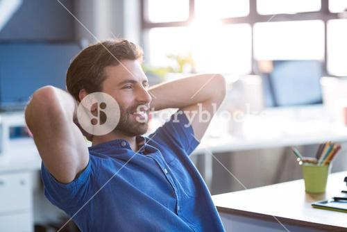 Graphic designer sitting in office
