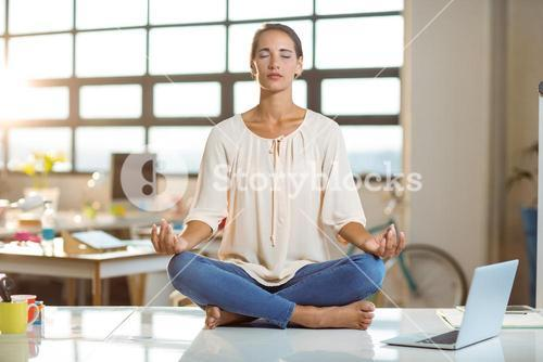 Business executive performing yoga