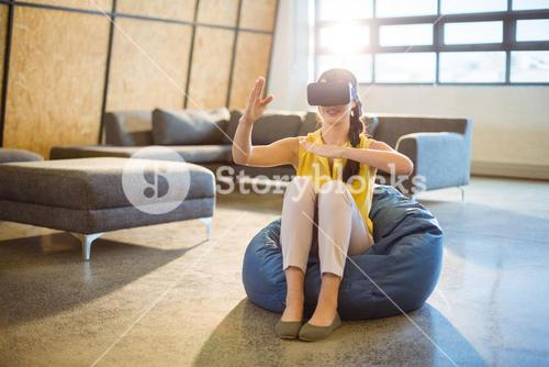 Female business executive using virtual glasses