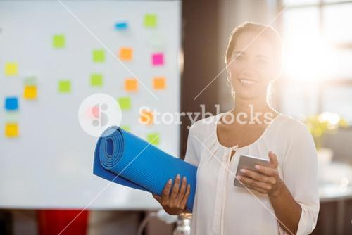 Female business executive holding mobile phone