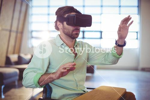 Male business executive using virtual glasses