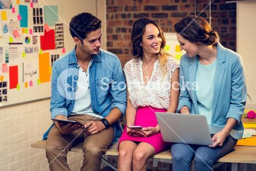 Business people using laptop, mobile phone and digital tablet