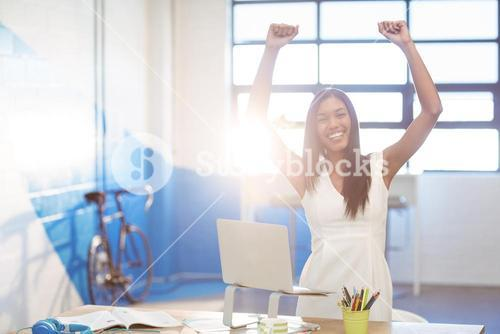 Business executive making fists in excitement