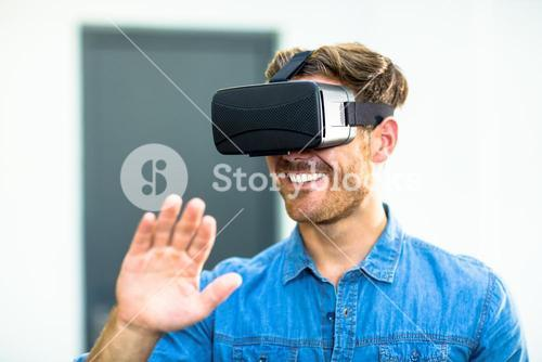 Young man using the virtual reality headset