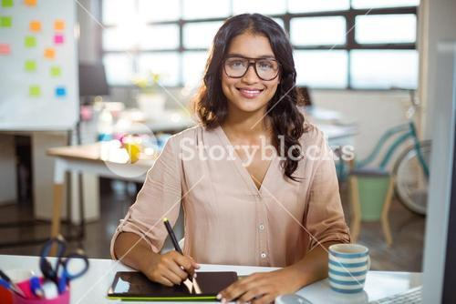 Businesswoman using graphic tablet