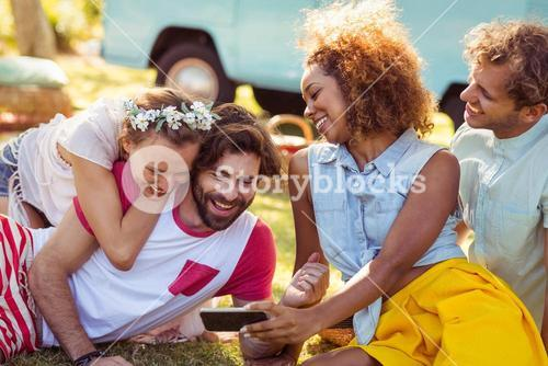 Group of happy friend using mobile phone