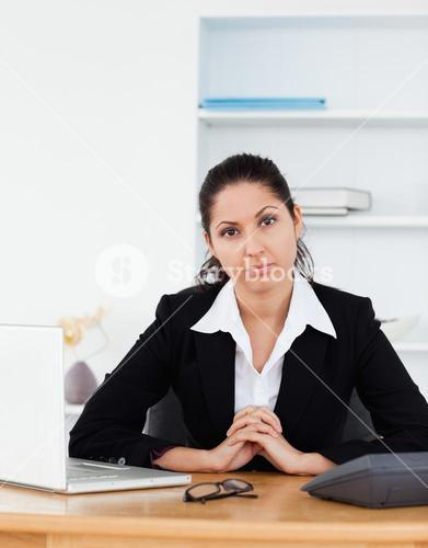 Confident businesswoman sitting in her office