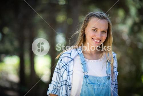Smiling woman standing in park