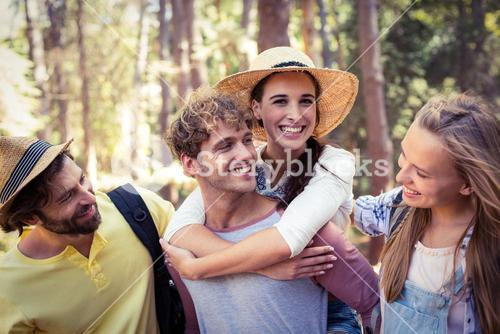 Group of friends having fun in forest