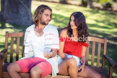 Couple arguing in park