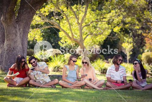 Group of friends using mobile phone
