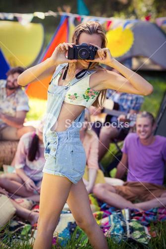 Woman taking a picture at campsite