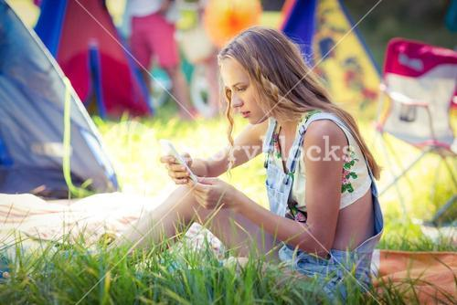 Woman using mobile phone at campsite