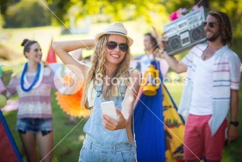 Woman taking selfie at campsite