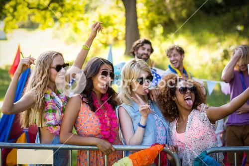 Friends clicking a selfie at music festival