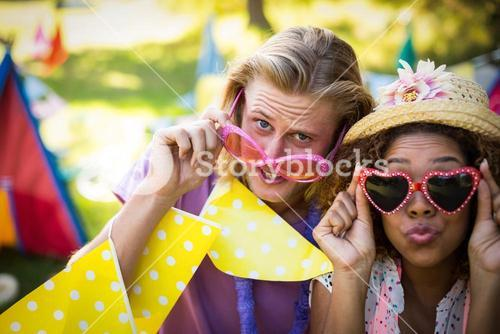 Friends in fancy sunglasses at music festival