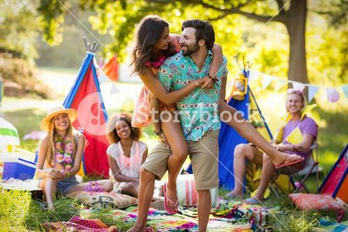 Couple dancing at campsite