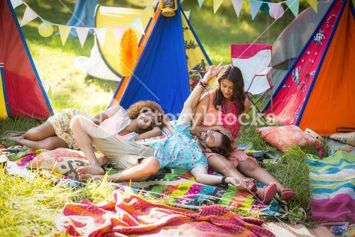 Friends relaxing at campsite