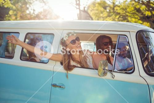 Woman looking out of campervan window