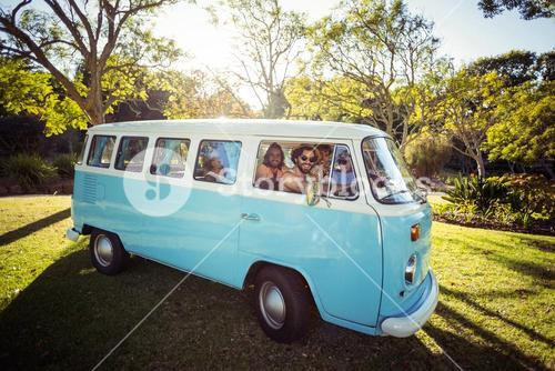 Group of friends travelling in campervan