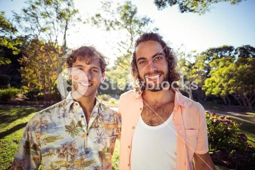 Portrait of two male friends smiling