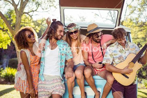 Group of friends having fun at music festival
