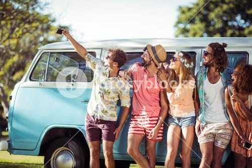 Group of friends taking selfie from mobile phone
