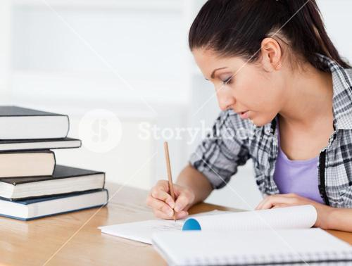 A young student is doing her homework